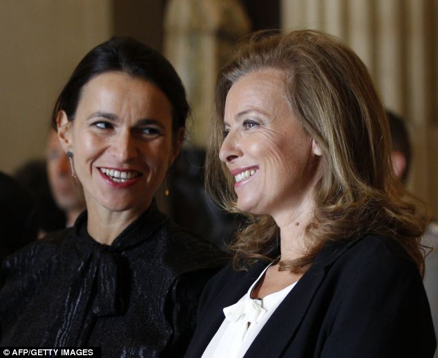 Influence: Ms Trierweiler (pictured here on the right with Culture minister Aurelie Filippetti) was at the Louvre to attend the opening of new galleries for the Department of Islamic Arts