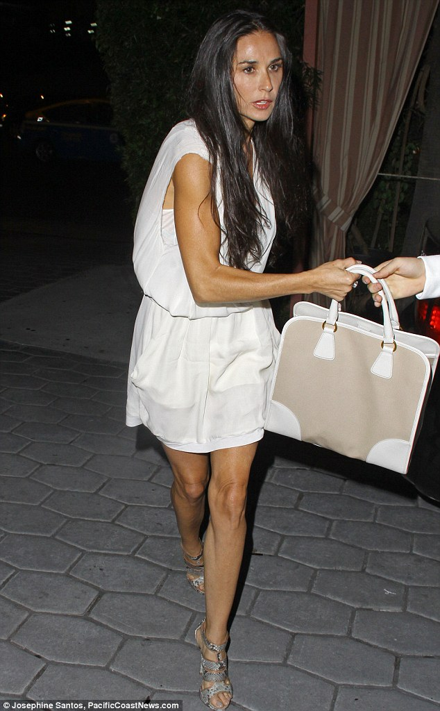 Frail: Demi Moore struck a worrying figure when she displayed her frail frame in a white minidress whilst leaving the Sunset Towers Hotel in West Hollywood on Wednesday night