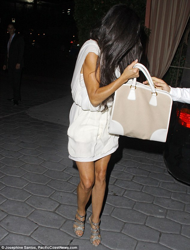 Disorientated: The actress had been dining at the upscale hotel with some friends, and when she emerged from the establishment she appeared somewhat wide-eyed and disorientated