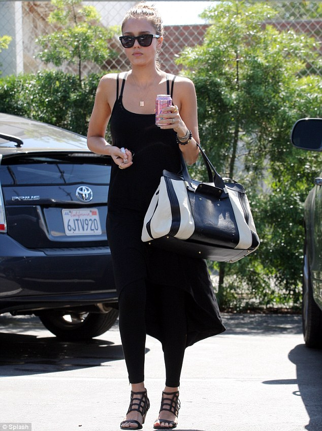 Here comes the boss: Jessica Alba visits her Honest Company offices in Santa Monica on Thursday