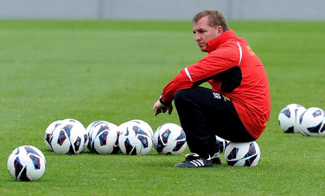 Ball boy: Liverpool manager Brendan Rodgers