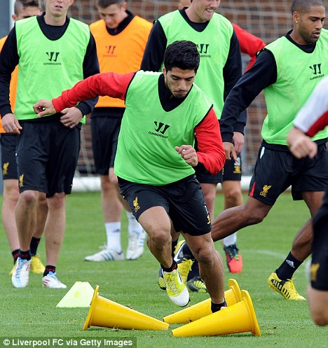 Focused: Suarez in training ahead of Sunday's match at Anfield