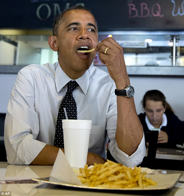 What will Michelle say? Obama pigged out on french fries during a campaign stop at OMG! Burgers in Miami on Thursday