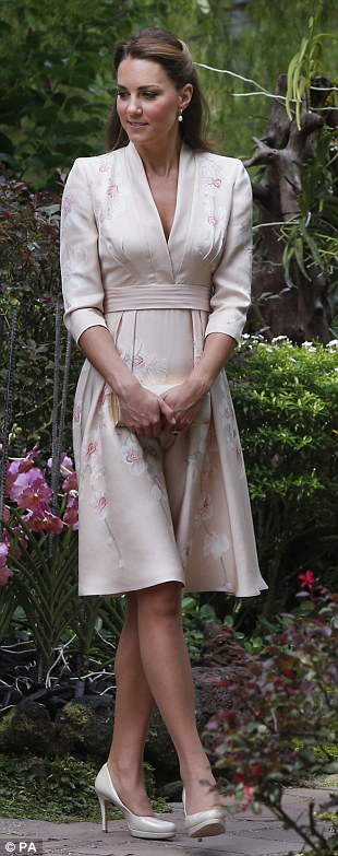 JENNY PACKHAM, £800: On the first day of the tour at an orchid garden in Singapore, the Duchess wore orchids of her own on this kimono style dress with her £195 LK Bennett courts