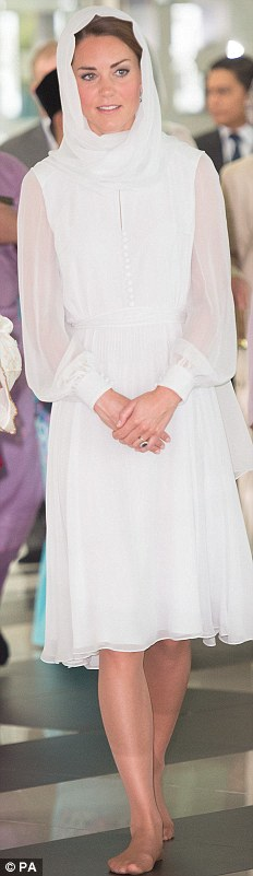 BEULAH, £895: The Duchess wore the cream dress with a headscarf and removed her shoes to visit a mosque in Kuala Lumpur