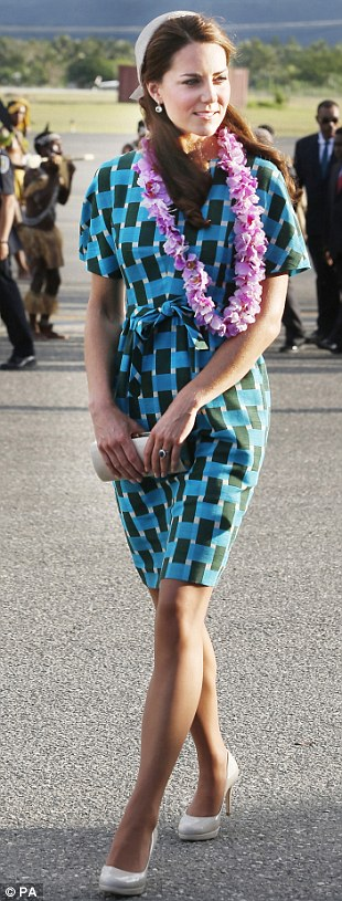 JONATHAN SAUNDERS, £840:The Duchess arrived at Honiara airport in the Solomon Islands wearing this bright cotton dress with a Jane Taylor designed hat
