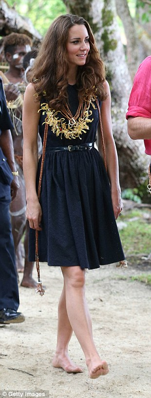 MULBERRY, £595: Barefoot on the beach, Kate wears this navy dress with traditional jewellery given to her by islanders