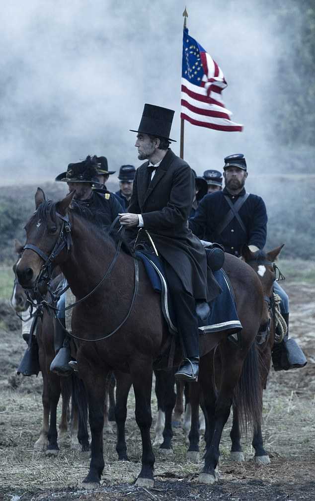 Taking charge: President Lincoln looks across a battlefield in the aftermath of a siege in a scene from the film