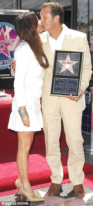Current love: The TV mogul getting a star on the Hollywood Walk of Fame with his third wife Roma in 2009