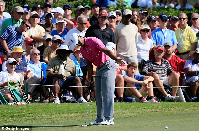 Tough day: Woods hit some splendid shots but then fluffed his lines on other holes