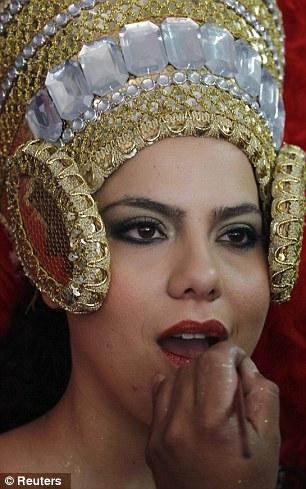 Inmates apply make-up to their chosen representative