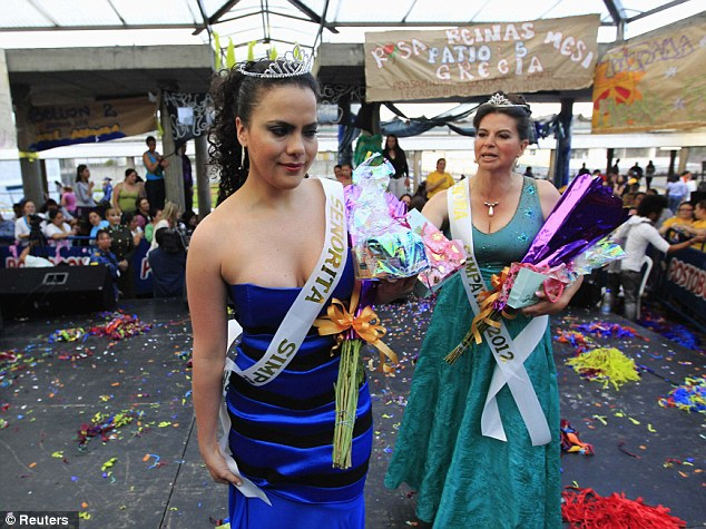 Emotional: Prison inmate Emma Urdinola is tearful after she is crowned the pageant queen with a tiara and sash