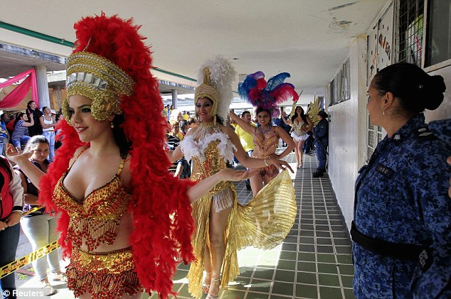 Unusual tribute: The inmates shimmy past their cells and other prisoners in the annual beauty contest held in September to honour the Virgin of Mercedes - the patron saint of prisons