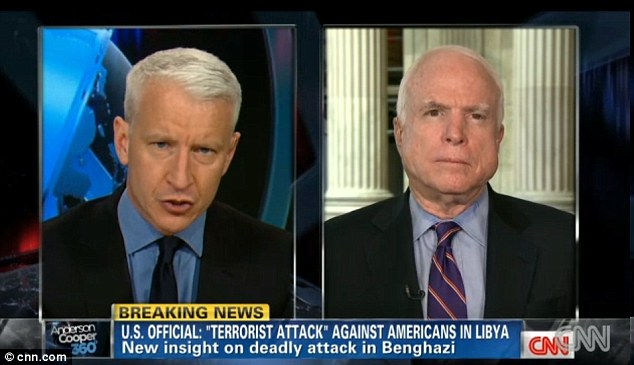 New revelations: On Wednesday, Anderson Cooper, left, told Senator John McCain, right, that a 'source familiar with Ambassador Stevens' thinking' said the envoy was worried about security