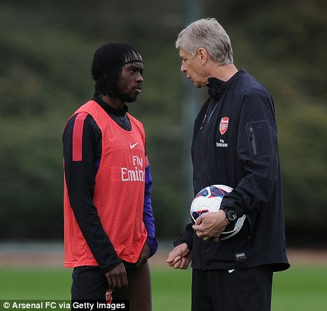 On a mission: Arsenal manager Arsene Wenger gets his point across to Gervinho during a training session