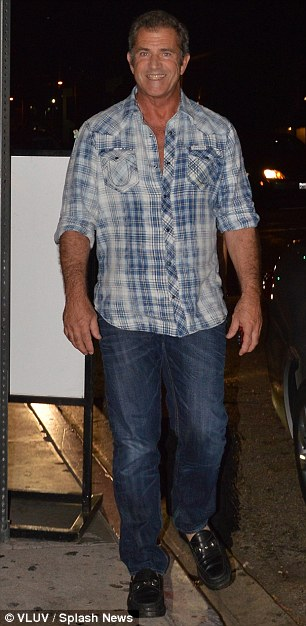 Excited! Mel Gibson walked out of STK restaurant with his girlfriend Nadia Lanfranconi on Friday