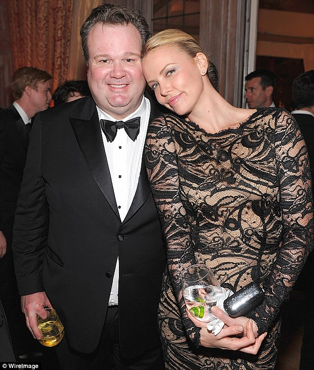 New love: Charlize Theron is said to have fallen for Modern Family star Eric Stonestreet, who she was pictured with in April at the White House Correspondents Dinner