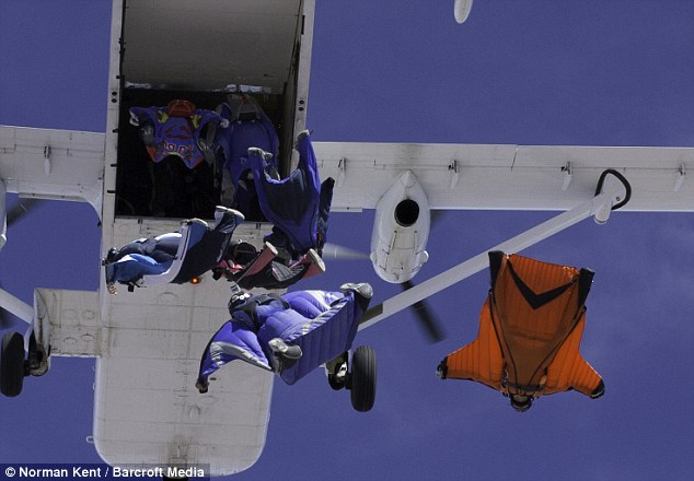 Fall to earth: The team jumped out of five separate planes above Perris Valley in Southern California