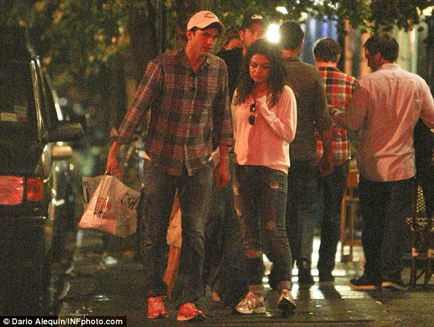 Save some for later: Ashton Kutcher and Mila Kunis were pictured leaving Spasso Restaurant in New York City with a doggy bag on Saturday