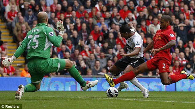Too late: Glen Johnson (right) tackles Antonio Valencia to concede a penalty