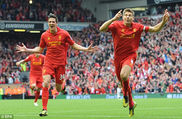 Looking to the heavens: Steven Gerrard (right) celebrates scoring the opening goal for Liverpool