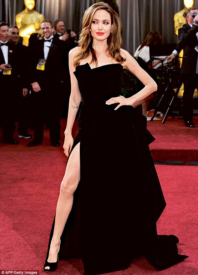 The original: Angelina caused a stir with her then-unique pose in a thigh-high split dress at the Oscars in February