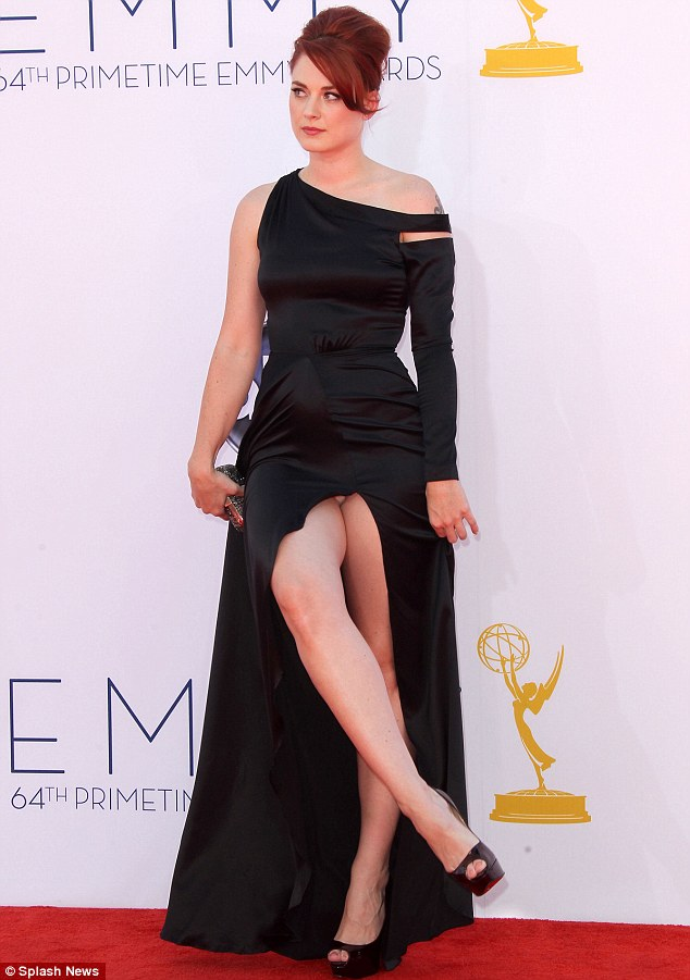 The perils of an Angelina leg! Alexandra Breckenridge flashed a bit too much as she posed on the red carpet at the Emmy awards on Sunday night