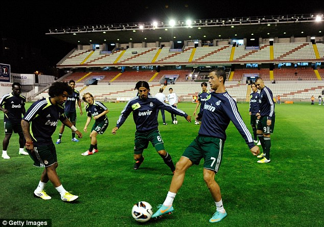 Take advantage: Real Madrid players, including Marcelo (left) and Cristiano Ronaldo (right), took part in a light training session