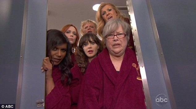 Toilet humour: The talented actresses come upon a distraught Emmy host, crouched in the corner