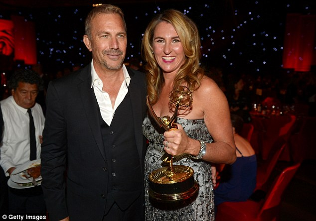 Party time: Kevin Costner and President of Entertainment and Media Nancy Dubuc. The Bodyguard star won best actor for his role in miniseries Hatfields & McCoys