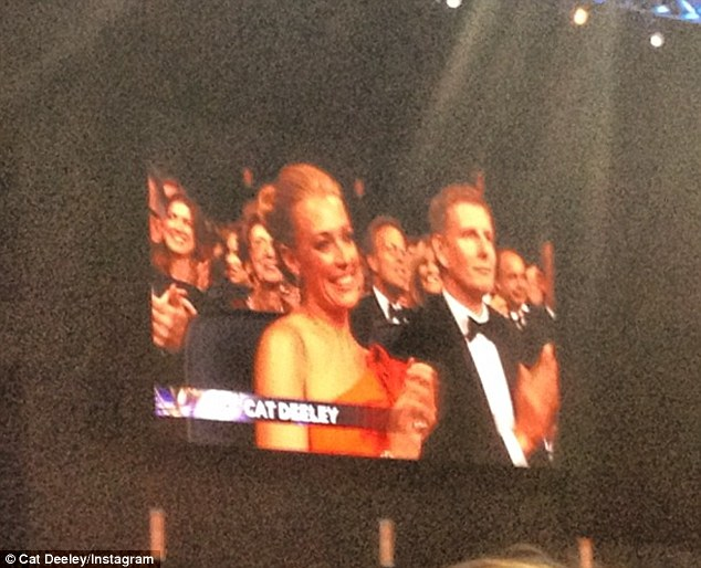 By her side: She also shared a photo showing Patrick loyally clapping as he sat by her side when her TV show got a mention at the awards