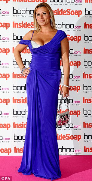 Over the top: Tricia Penrose showed off too much cleavage and too much fake tan in a form-fitting cobalt blue number