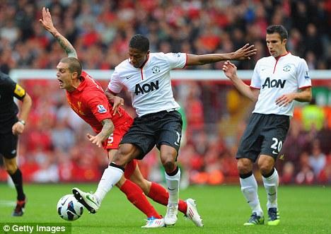 Blow: Antonio Valencia (centre) left United's training ground on crutches