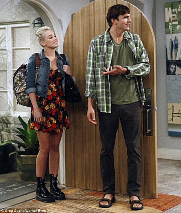 Look who's here! Miley stars as Missi in the episode, the daughter of one of Ashton's character Walden's friends