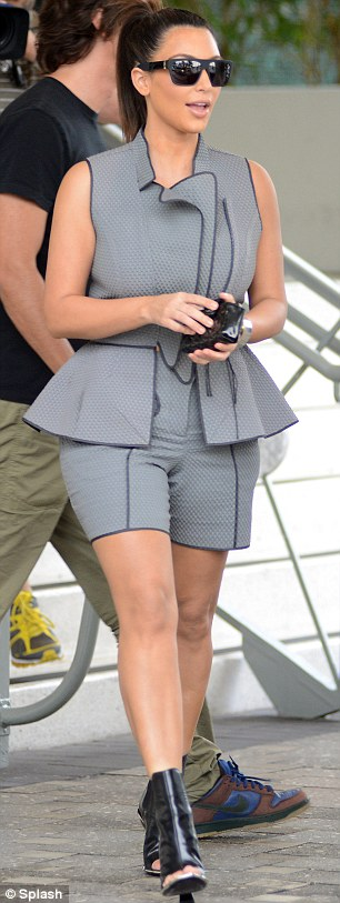 Not her greatest look: Kim wears bizarre shorts ensemble during a shopping trip in Miami