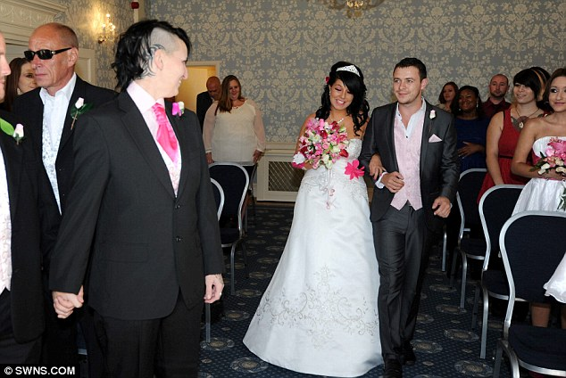 Here comes the bride: Kerry finally makes it down the aisle at the couple's no-expense-spared bash - held at the same venue where she had planned to marry a man