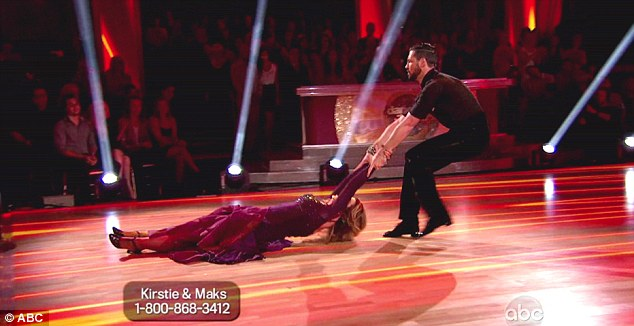 Dragging along: At one point, Maksim pulled Kirstie along the floor as part of the number