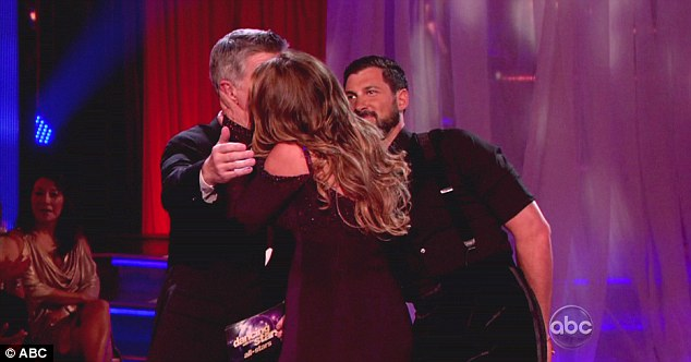 Bonus prize: Maksim looks on with amusement as Kirstie smooches with the Emmy-award winning host at the end of the show