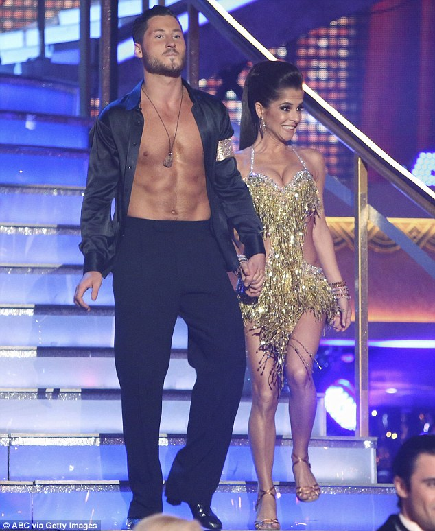 Check out those abs! Val displayed his enviable physique in an open black shirt