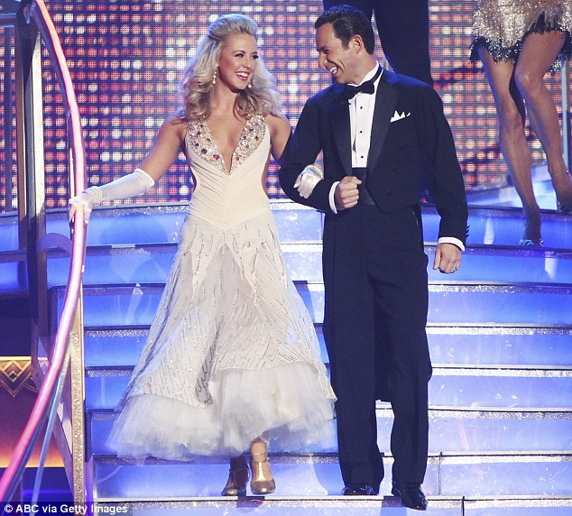 Glamorous: The pair looked as though they were heading to a prom as they descended down the stairs