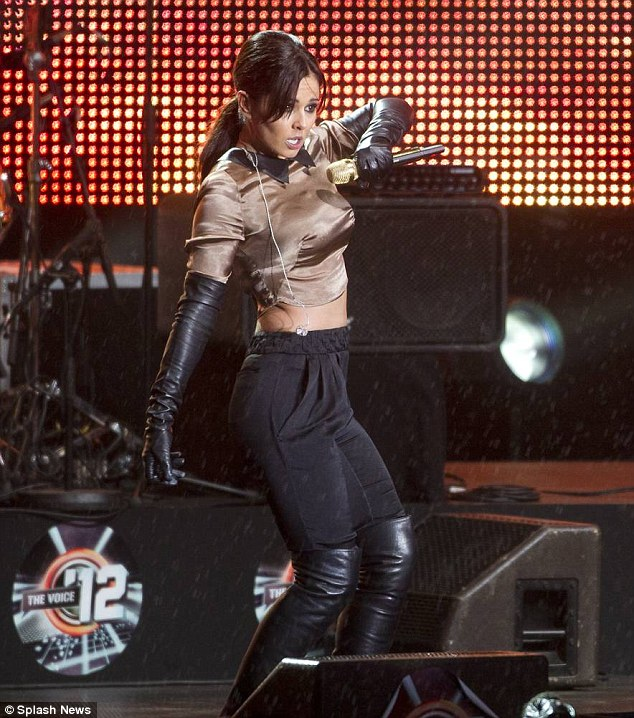 She's got the moves: Cheryl told fans that she was sorry if she missed out dance moves during her show due to the wet weather