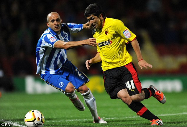 Struggling: Watford's Fernando Forestieri (right) battles with Brighton's Bruno Saltor