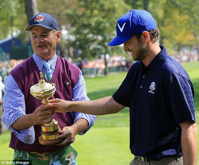 Don't be too hasty: Justin Timberlake and Bill Murray grabbed a hold of the Ryder Cup before they took part in the celebrity scramble at Medinah Country Club on Tuesday