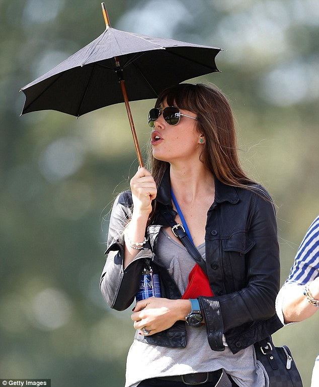 Brolly good: Jessica Biel seemed engrossed in the game as her fiance and Bill went swinging