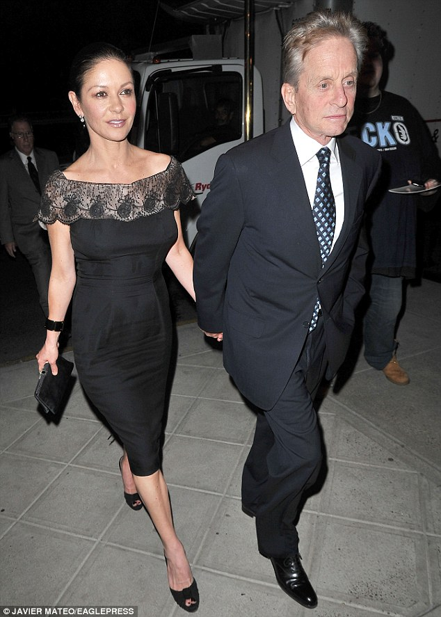 Power couple: Catherine Zeta-Jones and Michael Douglas out in Manhattan celebrating their same-day birthday
