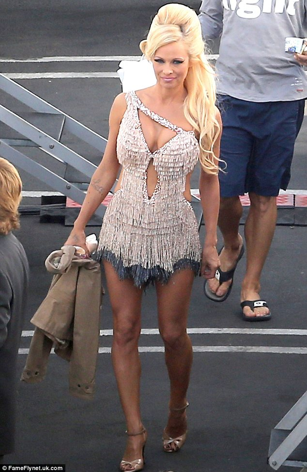 The best legs in the business: Despite being booted out of the competition last night Pamela Anderson wowed as she showed off her trim pins in her dance outfit as she made her way to Dancing With The Stars last night