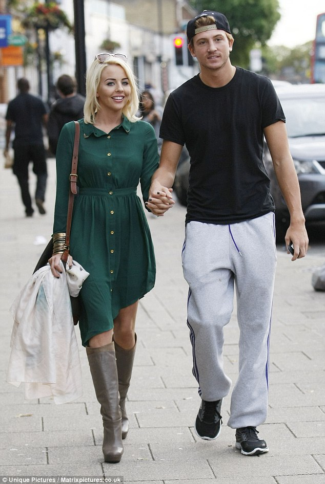 Fashionista: Lydia Bright looked chic and elegant in an emerald green dress, but her boyfriend Tom Kilbey let the side down in a scruffy ensemble