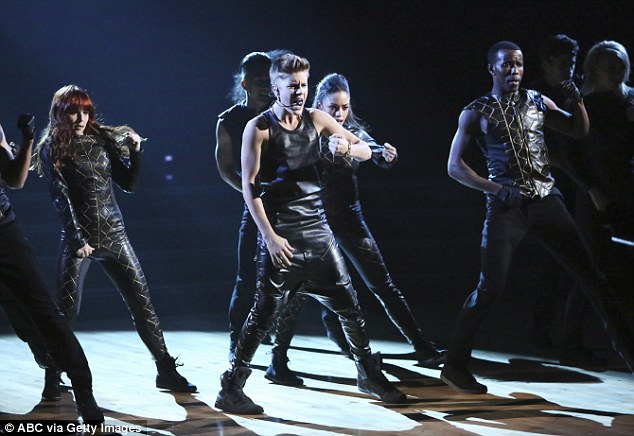 Teenage dream: Justin performed with a group of dancers for the energetic number