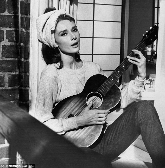 Movie classic: Moon River was originally written for Audrey Hepburn in the 1961 film Breakfast At Tiffany's although it later became synonymous with Williams
