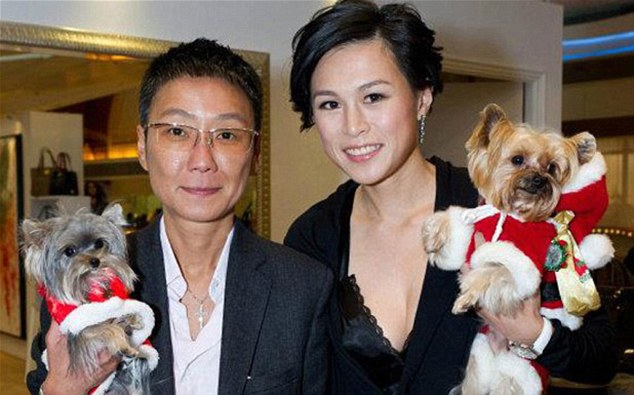 Definitely not single: Gigi Chao, right, and her partner Sean Eav, have been together for nine years and married in Paris in 2012